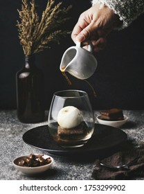 "An affogato (Italian for ""drowned"") is an Italian coffee-based dessert. It usually takes the form of a scoop of vanilla gelato or ice cream topped or ""drowned"" with a shot of hot espresso."