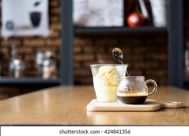 Affoghato , an expresso shot with one scoop of vanilla ice-cream. Selective focus with copy space, brick wall background.