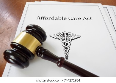 Affordable Care Act aka ObamaCare document with a legal gavel