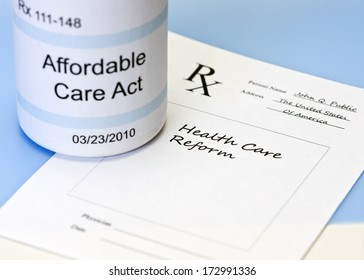 Affordable Care Act bottle on blue with prescription for health care reform.