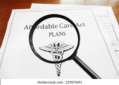 Affordable Care Act Plans document and magnifying glass