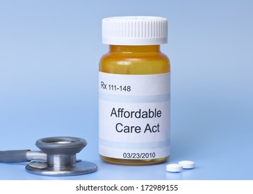 Affordable Care Act prescription bottle on blue with stethoscope and pills.