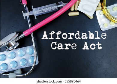 Affordable care act word, medical term word with medical concepts in blackboard and medical equipment.