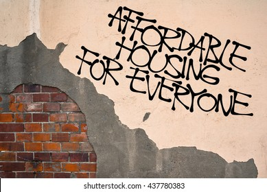 Affordable Housing For Everyone - handwritten graffiti sprayed on the wall, anarchist aesthetics. Appeal to provide social housing for poor people. Prevention against homelessness