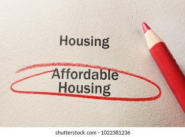 Affordable Housing text circled in red pencil, on textured paper
