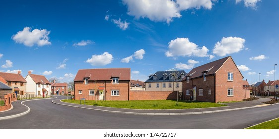 Affordable new build housing and summer sky.