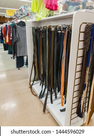Affordable Used Belts and Clothing for Sale on hanging Racks at a Thrift or Resale Store