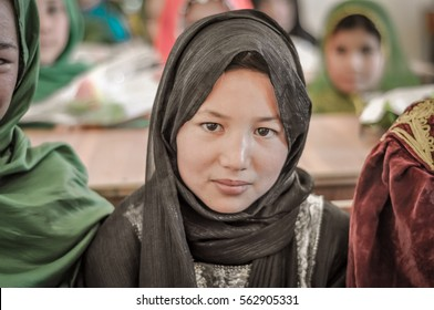 Afghanistan - circa October 2011: Young pretty girl wears black hijab at ADRA school in Afghanistan. Documentary editorial.