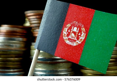 Afghanistan flag waving with stack of money coins macro