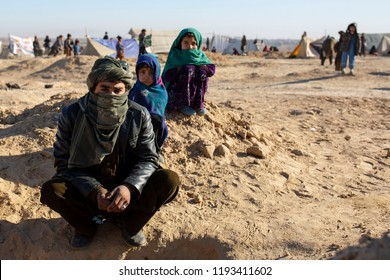 Afghanistan / Sheberghan - January 2018 - A father and his kids waiting help in refugee camp