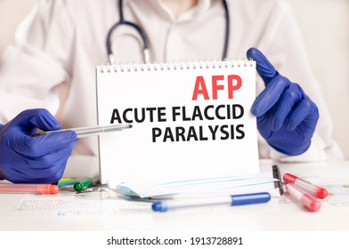 AFP card in hands of medical Doctor. Doctor's hands in blue gloves holding a sheet of paper with text AFP - short for Acute Flaccid Paralysis, medical concept.