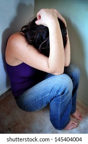 Afraid abused woman sit on the floor at home  - concept photo of sexual assault