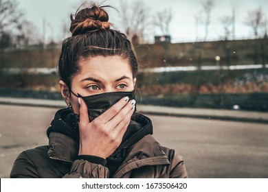Afraid of dangerous N-CoV 2019 influenza coronavirus. is wearing medical face masks to protect themselves from pollution, germs and coronavirus. Corona virus pandemic. girl with medical mask.
