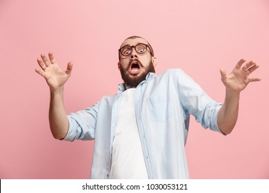 I'm afraid. Fright. Portrait of the scared man. Business man standing isolated on trendy pink studio background. Male half-length portrait. Human emotions, facial expression concept. Front view