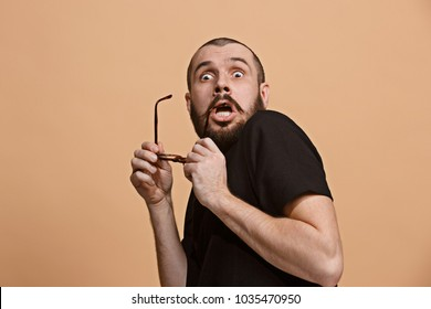 I'm afraid. Fright. Portrait of the scared man. Business man standing isolated on trendy pastel studio background. male half-length portrait. Human emotions, facial expression concept. Front view