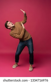 I'm afraid. Fright. Young cool man full body scared pose isolated on trendy pink studio background