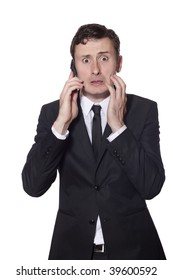 afraid looking businessman with a phone in a black suite isolated on white