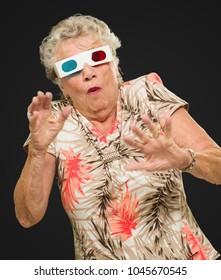 Afraid Senior Woman Watching 3d Movie On Black Background