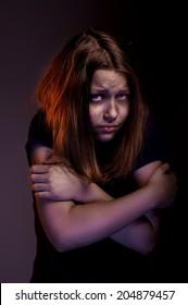 Afraided teen girl experiences fear