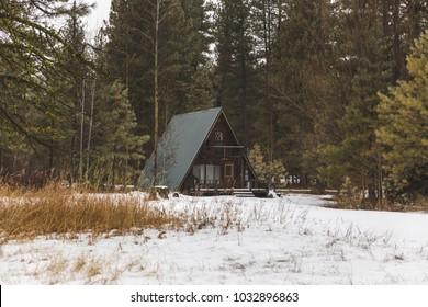 A-Frame cabin building in thick forest area. Featherville, Idaho, USA.