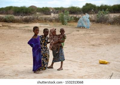 Africa, Kenya, Kenyan-Somali border -     Kenyan children stand next to their poor homes between the Kenyan and Somali borders - August 21, 2018