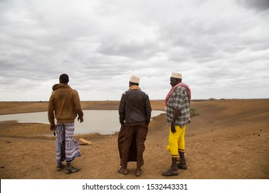 Africa, Kenya, Kenyan-Somali border -Men standing in front of the lake began to dry out of the water, causing water to smear the poor Kenyan villages - August 20, 2018,