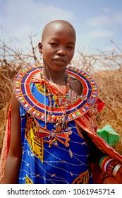 AFRICA, KENYA, MASAI MARA - JULY 2: unidentified Female tribal member wearing traditional attire posing for a portrait on July 2,2011, in Kenya