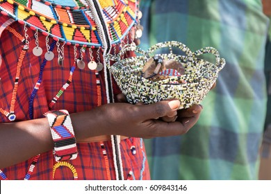 Africa, Kenya, Samburu National Reserve. A woman holding Tribal handicrafts, jewelry. 2016-08-04
