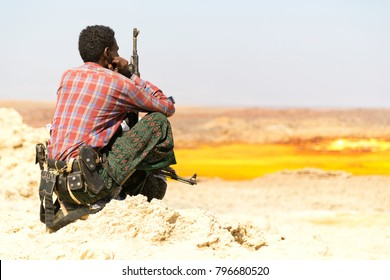 africa  in the land of danakil ethiopia a black soldier and his gun looking the boarder