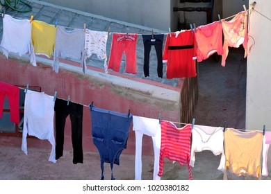 Africa - Morocco - clothes hanging out to dry outdoors - drying rack on the balcony