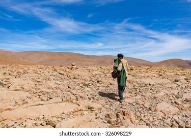 Africa, morocco - A Nomad walking in sahara desert