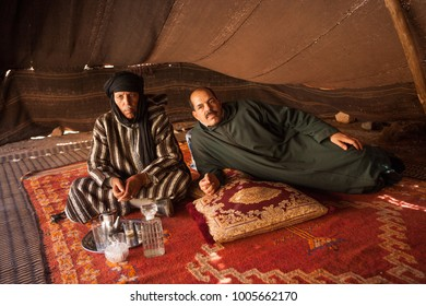 AFRICA, MOROCCO, REGION GUELMIM-OUED NOUN, SIDI IFNI PROVENCE - CIRCA FEB 2006 - Two Moroccian men welcome guests at Berber shelter at Abeino near Guelmim