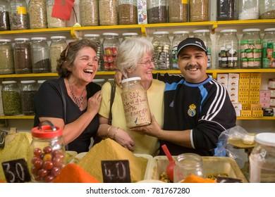 AFRICA, MOROCCO, REGION TANGER-TETOUAN-AL HOCEIMA - CIRCA FEB 2007 - two tourists having fun with a salesman at Souk at Agadir
