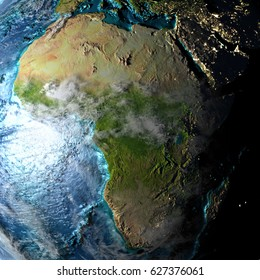 Africa on physical map with evening light. 3D illustration with detailed surface and visible city lights. Elements of this image furnished by NASA.