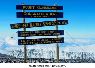 Africa, Tanzania, Kilimanjaro national park. Climbing to Uhuru peak - highest point of Kilimanjaro mountain and African continent. Information sign at Uhuru peak