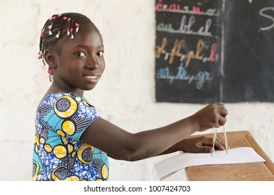 Africa and Technology - Beautiful African Girl at School with Compass and Blackboard