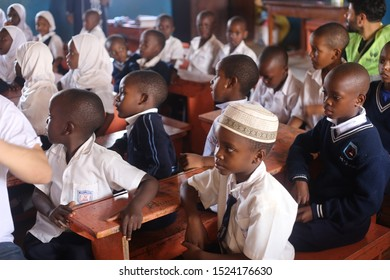 Africa, Uganda, 15.04.2019 Black children sitting in row at school