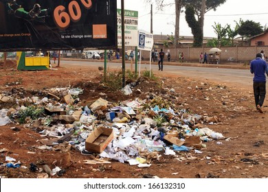 AFRICA,CAMEROON,DSCHANG - JANUARY 23: Heap of garbage beside the road on January, 23, 2013 in Cameroon. Lack of solid waste management is a major problem in most of urbanized Africa.