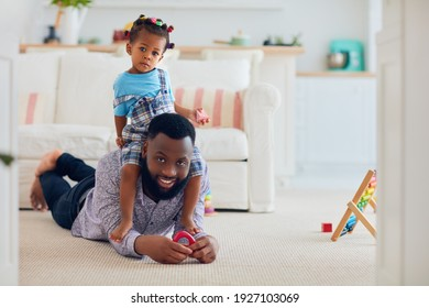 africam american family, father and daughter having fun together at home