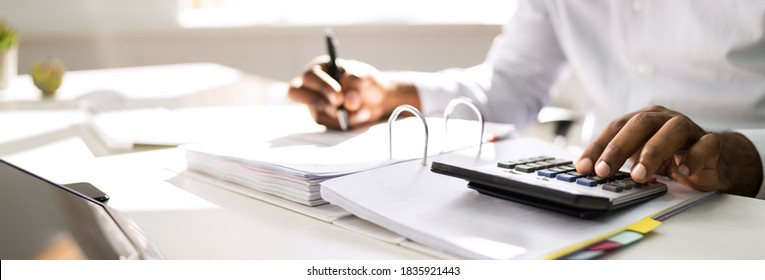 African American Accountant Doing Accounting And Tax