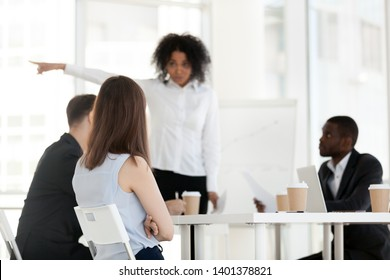 African American angry female boss pointing at door, ask female employee leave company meeting, mentor, business coach, businesswoman annoyed with workers misbehavior, bad work results, failure