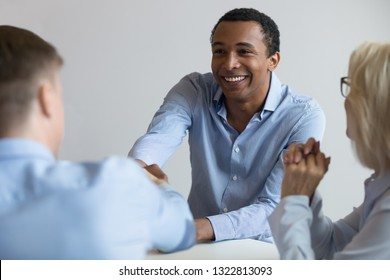 African American applicant, candidate on free vacancy shaking hand of employer at job interview, business partners handshaking at negotiations, manager welcoming new client, close up