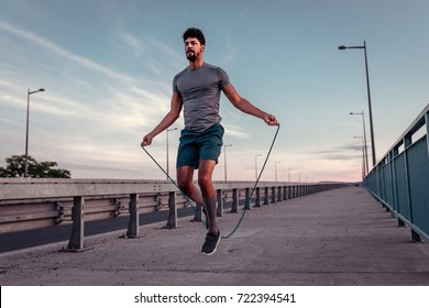 African american athlete man working out on a skipping rope.