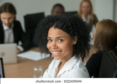 African american attractive businesswoman at meeting, smiling black employee, team leader or professional manager looking at camera, young woman business coach or corporate teacher head shot portrait