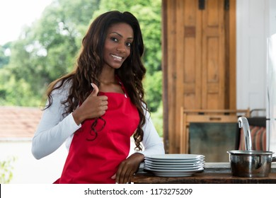 African american au pair girl at kitchen at kitchen at home