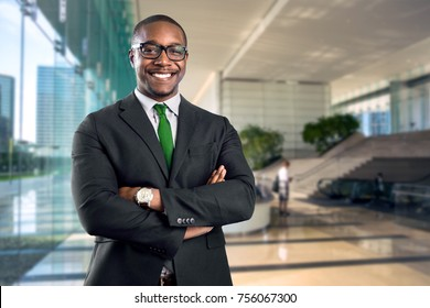 African american bank manager owner ceo business man standing confidently with pride in financial building