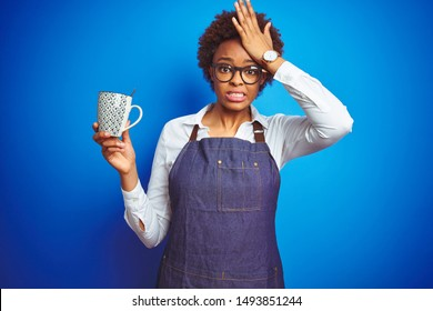 African american barista woman wearing bartender uniform holding cup over blue background stressed with hand on head, shocked with shame and surprise face, angry and frustrated. Fear and upset