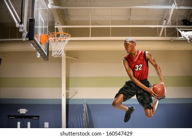 African American basketball player in action in indoor court