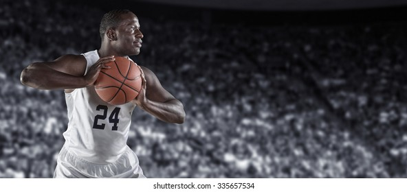 African American Basketball Player in a large basketball arena