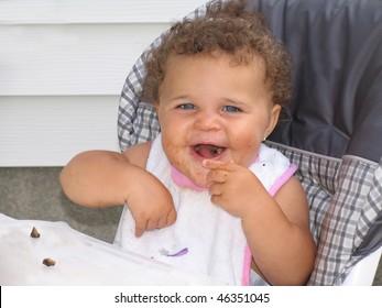 African American Beautiful Baby Blue Eyes Eating Food